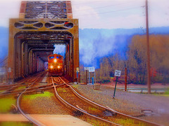 Warmified Railroad (PDX Bailey) Tags: bridge photoshop software modifed image bright color colorful wild rail tracks head lights sign grass smoke unusual weird