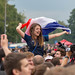 Young French woman waving a French flag