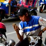 Man looking at his phone in Bangkok's Chinatown thumbnail