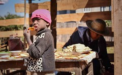 Street Boy Eating (Rod Waddington) Tags: africa african afrique afrika madagascar malagasy boy culture cultural child streetphotography woman food stall outdoor ethnic ethnicity