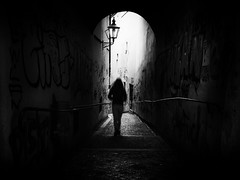 out of the darkness (Sandy...J) Tags: atmosphere atmosphäre alone allein photography fotografie passage durchgang darkness dunkelheit light licht walking women wand wall urban noir germany grafitti street streetphotography sw schwarzweis strasenfotografie stadt silhouette shadow sunlight blackwhite bw monochrom mono mood
