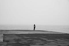 Waiting...?! (sebastianhillemann) Tags: 55mm bay water france girl people street normandy sea noireblanc monochrome schwarzweis blackwhite blackandwhitephotography bw bnw