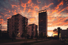 Burning Sky (Bunaro) Tags: aurinkolahti vuosaari helsinki suomi finland myhelsinki visitfinland beautyofsuomi cityscape landscape burning sky blazing orange cirrus tall buildings aparment house tower mad clouds reflection columbus