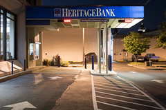 Heritage Bank (Curtis Gregory Perry) Tags: olympia washington night bank banking parking lot arrow paint stripe teller atm window cashier awning blue sign long exposure nikon d810 maximum clearance 10 feet