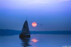 The Sea (gusdiaz) Tags: photoshop photomanipulation digital art arte artistico reflection reflejo sailboat bote agua cielo atardecer sol sun mar oceano sereno relaxing relajante canon canonphotography