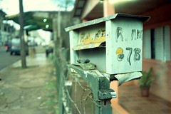 Buzón (mavricich) Tags: calle color compacta olympus misiones mju lomography film película motos árbol carretera bici edificio
