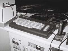 Commodore 16 home computer (Matthew Paul Argall) Tags: hanimex110if fixedfocus 110 110film subminiaturefilm lomographyfilm 100speedfilm 100isofilm grainyfilm grainy computer homecomputer commodore16 electronics joystick nintendowii