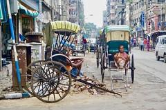 Hand pulled rickshaws, Kolkata (Yekkes) Tags: india asia kolkata calcutta street city urban decay traffic resting pensive thoughtful people rickshaw transport labour hardship handpulledrickshaw northcalcutta westbengal