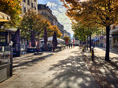Autumn in Geneva, Switzerland (` Toshio ') Tags: toshio geneva switzerland swiss europe european geneve suisse fall autumn october downtown city trees iphone shadow light people sidewalk cafe restaurant store shops