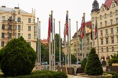 Flags of the Tourists' Nations [Explored] (Roy Prasad) Tags: green prague czechia flag hotel building travel vacation prasad royprasad sony a7r a7rm3 24105mm praha czechrepublic europe ilce7rm3