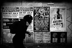 IMG_8184 (JetBlakInk) Tags: subjecttoground subject2ground billboard billstickers silhouette lowkey streetphotography streetscene afrocaribbean rastaman runner keepfit rucksack manonamission
