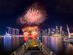 Second Nightmare (Scintt) Tags: singapore marina bay exposure light evening dramatic surreal travel urban exploration buildings cityscape city skyline architecture offices business tanjong pagar central district cbd financial scintillation scintt sky clouds residential hotel integrated resort casino exclusive tourism property dusk wide angle residences banks glow orange water twilight epic long slow shutter haidafilter nanopro stitched panorama fireworks display joyous celebration nationalday parade ndp mbs sands esplanade artscience pier bridge waterfront night jonchiangphotography