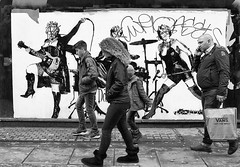 Walk This Way, Talk This Way, Must Be Run-DMC Fans (tcees) Tags: allfreepicturesjuly2018challenge greatmarlboroughst london w1 soho mural art graffiti sidewalk pavement man woman building wall bag people x100 fujifilm finepix bw mono monochrome blackandwhite streetphotography street mobilephone boots band urban loretto