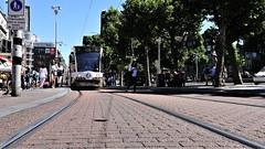Tram (bLiCk-WiNkL) Tags: strasenbahn bahn schiene strase pflaster pavement sky blue people publictransport women men mann frau frauen amsterdam rail railway city town dutch netherland netherlands trip citytrip