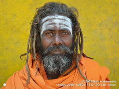 2014-11a Sadhus from Nepal 2018 (05) (Matt Hahnewald) Tags: matthahnewaldphotography facingtheworld character head face forehead painted sacredash vibhuti tripundra eyes catchlights reflexion smilingeyes expression fullbeard longhair dreadlocks consent rapport concept humanity travel tradition religion brotherhood anthropology spiritual religious traditional holy hindu hinduism shaivism shaivitesadhu shiva guru baba yogi devotee worshiper kathmandu nepal nepali individual oneperson male adult man photo detail backdrop skintone physiognomy nikond3100 primelens 50mm 4x3 horizontal street portrait closeup headshot outdoor color posing awesome authentic smilingmouthclosed nikkorafs50mmf18g lookingcamera fullfaceview clarity pashupatinath 1200x900pixels