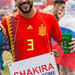 Soccer fan wearing a sign with #shakirapique hashtag
