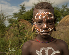 The Mursi Boy (Omo Valley, Ethiopia 2014) (Alex Stoen) Tags: 1dx africa african alexstoen alexstoenphotography boy canon canoneos1dx child creativelighting culture ef1635f28liiusm ethiopia facesofabyssinia geotagged militiavillage mursi natgeo nationalgeographicexpeditions omovalley paintedface pocketwizard portrait serious tradition travel tribes context facebook offshoeflash