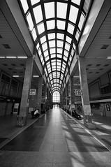 temple of traveling (rafasmm) Tags: łódź lodz poland polska europe railway station kaliska main hall building travel bw blackwhite black white photography urban city architecture monochrome perspective indoor nikon d90 sigma 1020 ex
