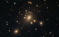 Hubble Reveals a Cosmic Distortion (NASA's Marshall Space Flight Center) Tags: nasa marshall space flight center msfc goddard gsfc hubble telescope solar system beyond esa european agency universe astronomy galaxy galactic cluster stars star formation 6dfgsgj1336001033130 sdssj13360331