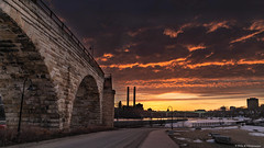 Stone Arch Bridge, Minneapolis, Minnesota (Neha & Chittaranjan Desai) Tags: mineapolis minesota stone arch bridge dawn sunrise sky travel city cityscape landscape snow winter red usa