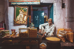 Hanuman. Udaipur, India (Marji Lang Photography) Tags: hanuman india indianfood indiansubcontinent northindian rajasthan travelphotography udaipur bhel colorphotography colors composition documentary food foodstore frame groceries horizontal indian indiansweets indoor indoorportrait localfood localstore man ministore northernindia oldman oneman oneperson painting people photography portrait rajasthani seller sitting store streetportrait sweets tourism travel travelimages travelinrajasthan travelpictures