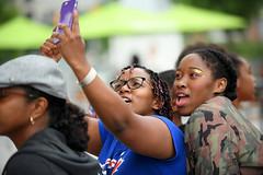 Girlfriend, Lets Get A Selfie Togetha (Poocher7) Tags: people portrait female girls girlfriends friends selfies cellphonephotography braidedhair braces torontobluejaystshirt camojacket teens fun socamusic concert iriemusicfestival2018 mississauga ontario canada caribbean nikon d850 candid