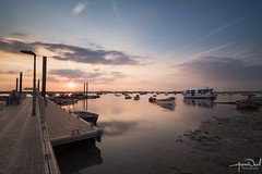 Jetty Sunset (AndyNeal) Tags: landscape seascape sea sky sunset beach essex mersea merseaisland island longexposure neutraldensityfilter sun tranquil bright vibrant clouds boats harbour jetty milkysea