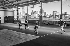 Big Apple Handball (John St John Photography) Tags: brooklynbridgepark pier2 brooklyn newyorkcity newyork streetphotography candidphotography brooklynbridge men playing handball bigapple cityscape people peopleofnewyork bw blackandwhite blackwhite blackwhitephotos johnstjohnphotography