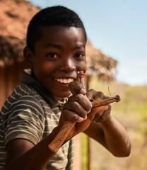 Slingshot  (in explore) (Rod Waddington) Tags: africa african afrique afrika madagascar malagasy boy culture cultural child slingshot shanghai hut outdoor ethnic ethnicity village