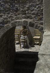 The Priestess (Kostis Tatakis) Tags: monemvasia peloponnesus peloponnese mani greece castle stonewall arch woman youngwoman whitedress dress beautiful candid people seated nikond7200