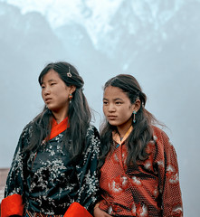 Bhutan: Spectators at Gasa Tshechu. (icarium.imagery) Tags: bhutan canoneos5dmarkiv buddhist captureone festival gasafestival gasatshechu gasavalley himalayas localpeople naturallight rural sigma100400mmf563dgoshsm spectators streetportrait traditional traditionalclothing traditionaldress travel tshechu vibrant women girls two sundaylights