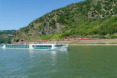 Boat Cruise on Rhine - DSC_0415 (John Hickey - fotosbyjohnh) Tags: 2018 cologne germany july2018 river riverrhine landscape scenic riverboatcruise mountain hill riverbank nikon sky rivercruiseboat boat train freighttrain hillside