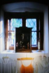THE ORANGE DRESS BETWEEN TWO WHITE ONES IN THE CASTLE (LitterART) Tags: kleid cloth dress window fenster schärding schloss castle pinhole fujifilm