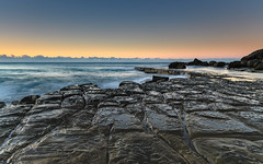 Tessellated Rock Platform and Seascape (Merrillie) Tags: forrestersbeach sand nature dawn tessellate surf wamberal newsouthwales sea morning beach ocean tesssellation coastal outdoors daybreak landscape australia tessellatedpavement weather waves earlymorning sunrise rocky tessellated rocks water blueskies centralcoast nsw seascape sky coast waterscape seaside