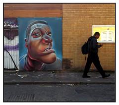 STREET ART by WOSKERSKI (StockCarPete) Tags: woskerski character facetotheglass streetart londonstreetart urbanart graffiti london uk window reflection pedestrian pavement brickwork