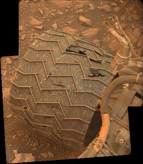 The Effects of Sharp, Pointy Rocks (sjrankin) Tags: 20july2018 edited nasa mars msl curiosity galecrater panorama wheel undercarriage rocks sand hole damage