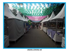 The stalls of the festival... (Guilherme Alex) Tags: stalls street inthestreet festival fair square life living walking happy people line angle guide composition flags high colorful green pink white cloudyday tree contrast culture city cityscape citylife citycenter cityview cityday cityculture mycity mylife myworld event food concrete citizen urban urbanization live lines teófilootoni minasgerais brazil brasil wonderful local amateur shot samsung dv100 digitalcamera digital quality yeah nice simple concept wood way
