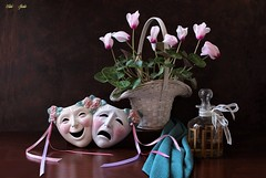 Laughter and Tears (Esther Spektor - Thanks for 12+millions views..) Tags: stilllife naturemorte bodegon naturezamorta stilleben naturamorta composition creativephotography art tabletop plant cyclamen mask laughter tears basket bottle ribbon scarf flowers glass ceramics wicker decorative bow ambientlight white pink green golden teal brown spring estherspektor canon