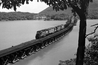 CR SD35 6028 (ex-PC), SD45 3913 (ex-EL), GP403199 (ex-PC), SDP45 3655 (ex-EL) north bound on Iona Trestle NY, summer 1976
