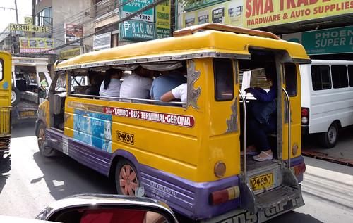 """Ten-person, hop-on, open-air """"bus"""""""