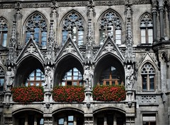 Neues Rathaus (SM Tham) Tags: europe germany munich marienplatz neuesrathaus newtownhall gothicstyle architecture building facade windows arches statues sculpture windowboxes planterboxes plants flowers