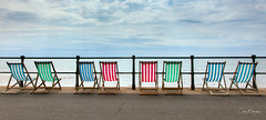 Seaside Rendezvous (clive_metcalfe) Tags: deckchairs seats seaside devon promenade summer