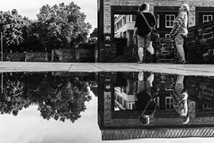 Up in the sky? Up in the sky! (Zesk MF) Tags: bw blak white people street candid pfütze puddle reflection spiegelung mirroring zesk mono water wasser up sky