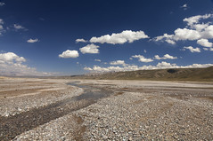 Naryn district - Kyrgyzstan (Joost10000) Tags: river riverbed gravel moraine landscape landschaft outdoors adventure sky grass mountains clouds tienshan eos canon canon5d travel kyrgyzstan asia centralasia summer wild wilderness natur nature scenic naryn oblast narynoblast