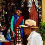 Elderly Tibetan woman in the doorway of a store in  Boudhanath Stupa in Kathmandu, Nepal thumbnail