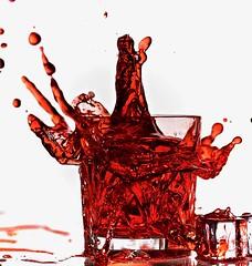 Refreshing Splash (johnsinclair8888) Tags: splash refreshment nikon speedlight backlight red strawberry johndavis macromonday sliderssunday stopaction reflection