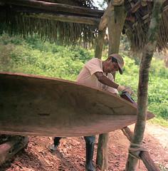 Dugout Nimbus 2000 (fotobloki) Tags: dulceriver riodulce guatemala river hasselblad opticfilm120 120 mediumformat plustek portra160 kodak dugoutboat boat handmade wood working localpeople offthebeatenpath rural travelphotography analogue film color hasselblad500c 80mmf28 carl boats adugoutboat