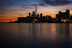 Toronto Sunsets (Paul Flynn (Toronto)) Tags: toronto sunset long exposure city skyline reflection water lake harbour sky cityscape dusk golden hour