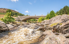 The Elan Valley ,Mid Wales (williamrandle) Tags: elanvalley claerwenreservoir midwales wales uksummer 2018 river water rapids bridge arch structure rocks bluesky hills trees blue greem outdoor landscape nikon sigma816mmf4556hsm sky tree