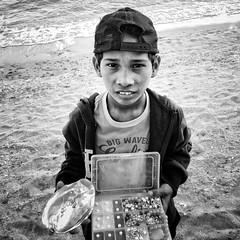 Boy by the seashore (Stitch) Tags: 100strangers stranger boy pearl vendor jewelry seashore beach resort weekly sanjuan batangas philippines weeklyplusten